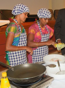 Farmers from India prepare food as part of the Expo Milano 2015 (Bioversity International/Pablo Gallo)