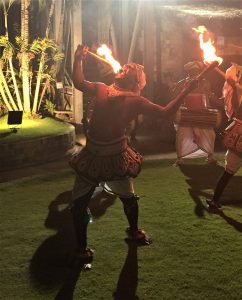Performers eating fire at the reception