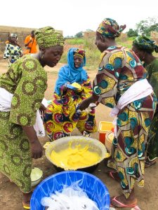 Women cooking with cassava (Photo credit: HarvestPlus)