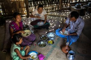 A family eating together in Khagrachari, Bangladesh (Photo credit: IFPRI PSSRP Bangladesh)