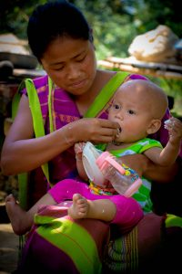 Feeding rice and dried fish paste in Khagrachari, Bangladesh (Photo credit: IFPRI PSSRP Bangladesh)